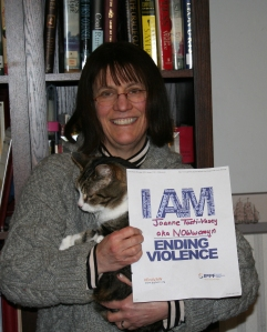 "Picture of Joanne Tosti-Vasey standing with sign that says ""I AM Ending Violence"""