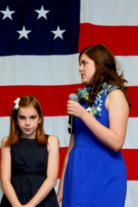 Picture of Caraline and Elle Shaheen singing The Star Spangled Banner