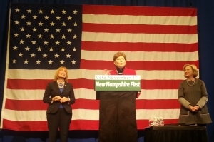 picture of NH Gov. Maggie Hassan and Sen. Jeanne Shaheen with Hillary Rodham Clinton standing on stage at a GOTV rally in Nashua, NH on Nov. 2, 2014