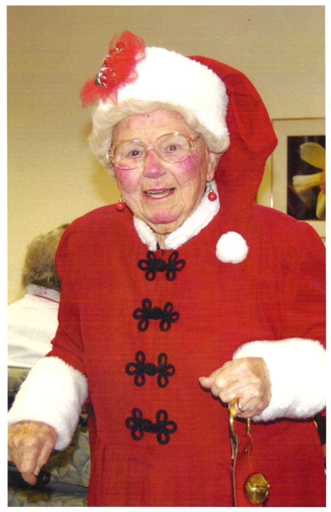 Picture of Aunt Frankie wearing her Mrs. Claus suit.
