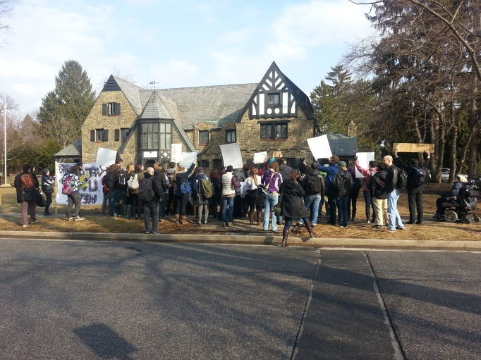 "Picture of protesters shouting ""Shame on You"" in front of the Kappa Delta Rho House in State College, PA"