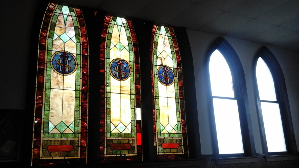 Picture of the stained glass windows in need of repair at St. Paul's AME church in Bellefonte, PA