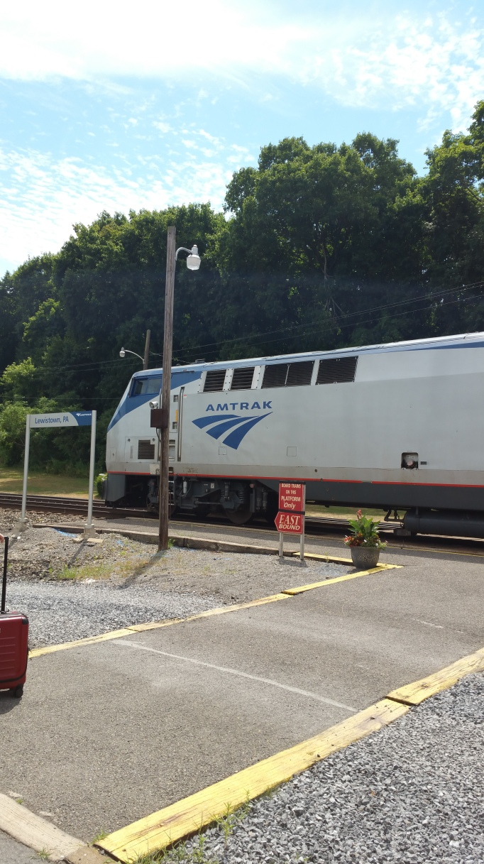 picture of the Amtrak engine pulling the passenger cars at the Lewistown train station.