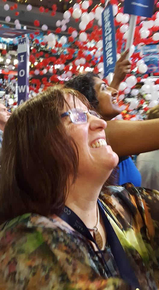 Picture of Joanne Tosti-Vasey watching the balloons drop from the ceiling of the Wells Fargo Center