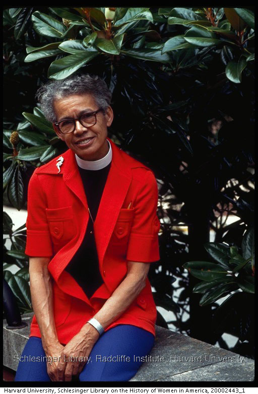 picture of Rev. Pauli Murray seated in front of a Magnolia tree.