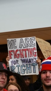 "Hand-drawn sign that says, ""We are fighting for what's right."""