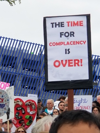 "Sign saying, ""The time for complacency is over!"""
